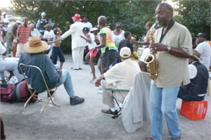 Musician playing sax in drum circle