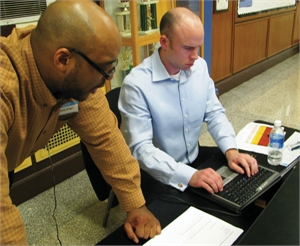 Two people working on laptop at Lawndale meeting